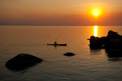 Kayaking at Mumbo island at sunset, Lake Malawi National Park, Malawi