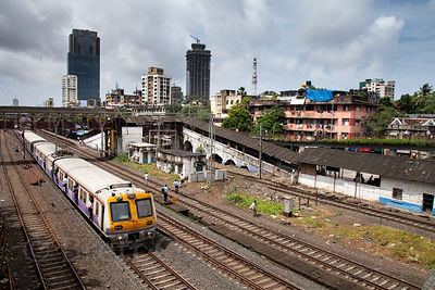 A train passes by the Mahim Railway Station, Mumbia, India.