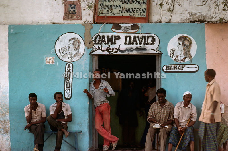 The name on a popular bar bears witness to Somalia's tendency to swim against the tide. Although a member of the Arab League,...