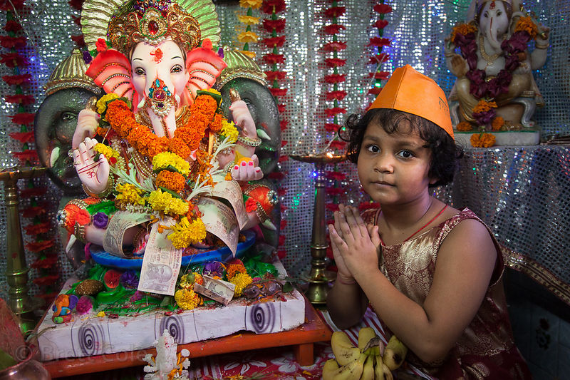 A family performs puja to Ganesh in their home in the Lalbaug neighborhood of Mumbai, India. Lalbaug is the epicenter of the ...