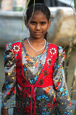 A girl on the Ganges River during Chhath Puja, Varanasi, India. Chhath Puja is a devotion to the Sun God Surya in which peopl...