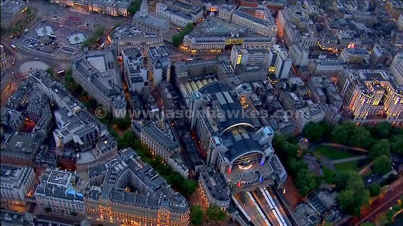 Aerial footage over Embankment at dusk, London, England, UK