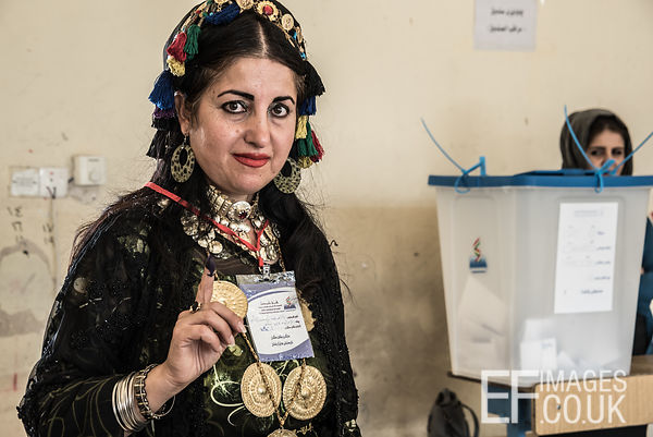 Proudly displaying an ink covered finger, indicating that she has voted in the Kurdish Independence Referendum, this lady is ...
