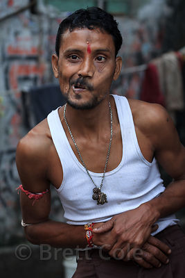 A man strikes an odd pose in Shyambazar, Kolkata, India.