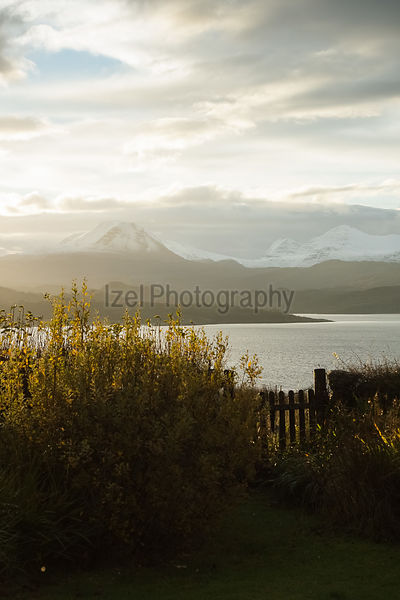 A garden gate leading out to Gairloch with the summits of Baosbheinn, Sgurr Mhor & Na Rathanan in the distance.