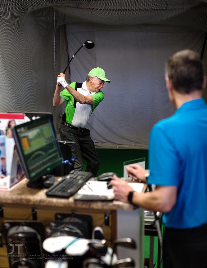 Owner Bruce Brooke assists Jon Styre in fitting for swing-specific specifications on a Swingbyte enabled machine at GolfUSA o...