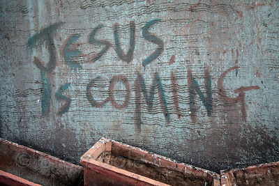 "Graffiti reading ""Jesus is Coming"" on a wall in Parel, Mumbai, India."