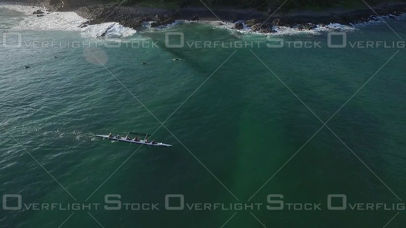 Outrigger dropping off a wave Noosa Australia