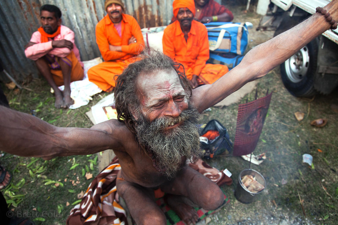 A sadhu (holy man) in Kolkata, India gestures as he prepares to make a pilgrimage to Sagar Island in the Bay of Bengal for th...