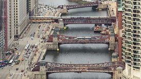 Close Up: Busy Bridges Carrying Heavy Traffic Over The Chicago River & Clearing Crossroads