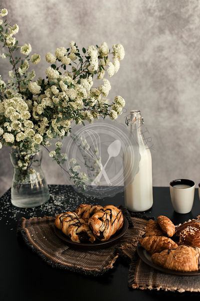 FRESH BAKED CROISSANT  ON THE BLACK TABLE AND RUSTIC BACKGROUND