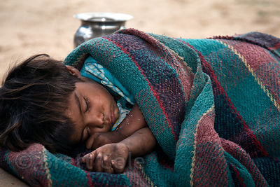 Sleeping toddler with no parents anywhere in sight, Pushkar, Rajasthan, India