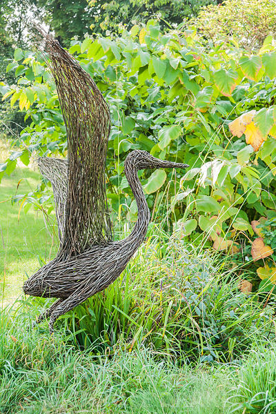 Woven willow bird beside the Canal Pond. Forde Abbey, nr Chard, Dorset, UK