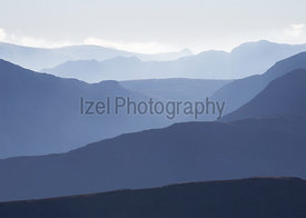 Cold misty morning over the ridge lines Derwent Fells in the English Lake District, UK.
