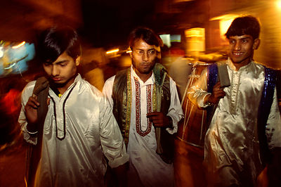 India - New Delhi - Musicians return to Shadipur after a night's work.