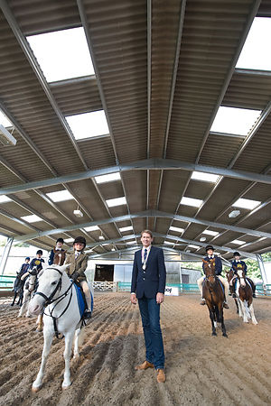 HOOF PLAQUE PRESENTATION  - Emile Faurie International Dressage Rider [GBR] presents commemorative to  Mount Mascal Stables  ...