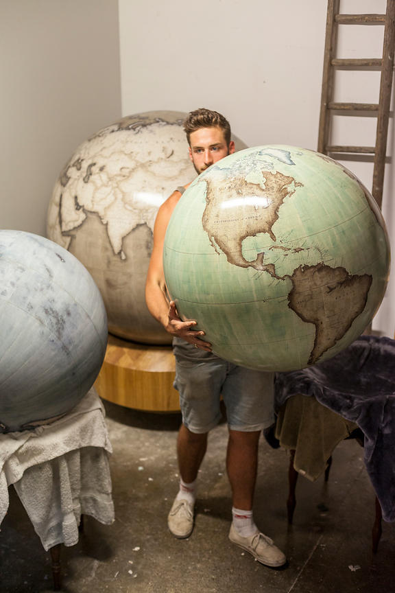 UK - London - A gloge is taken from the storeroom, Bellerby and Co. Globemakers