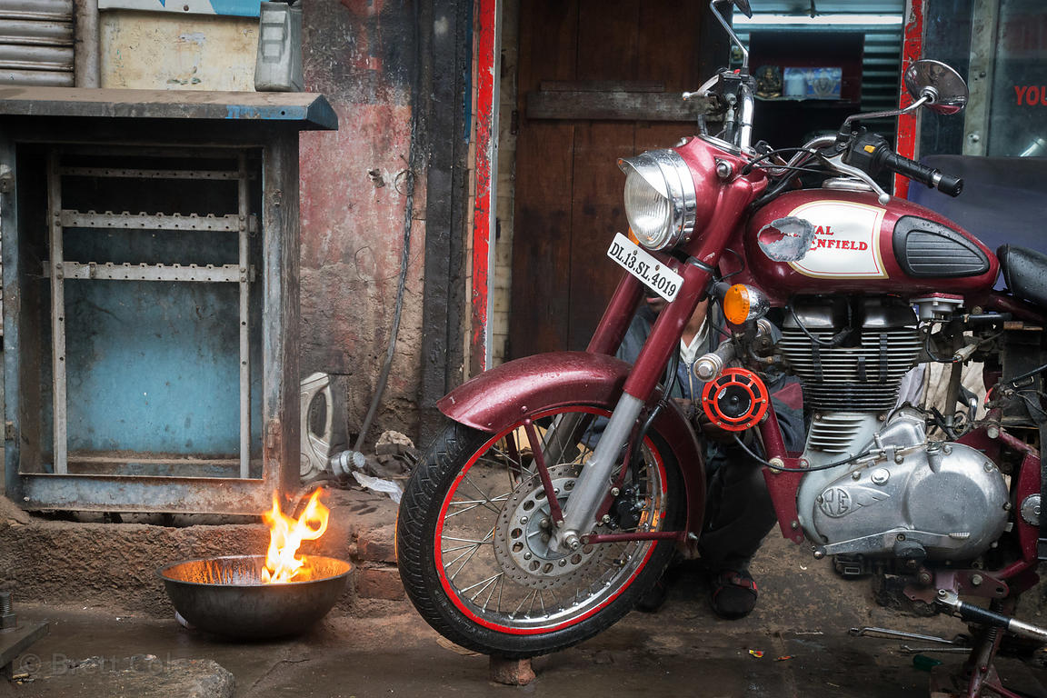 Fire and Royal Enfield motorcycle in Delhi, India