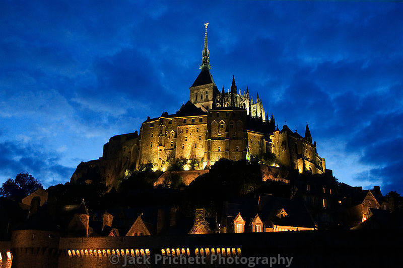 Mont St Michel glows against evening sky