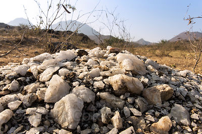 A natural mound of quartz rock in the desert, not associated with mining operations, Kharekhari village, Rajasthan, India