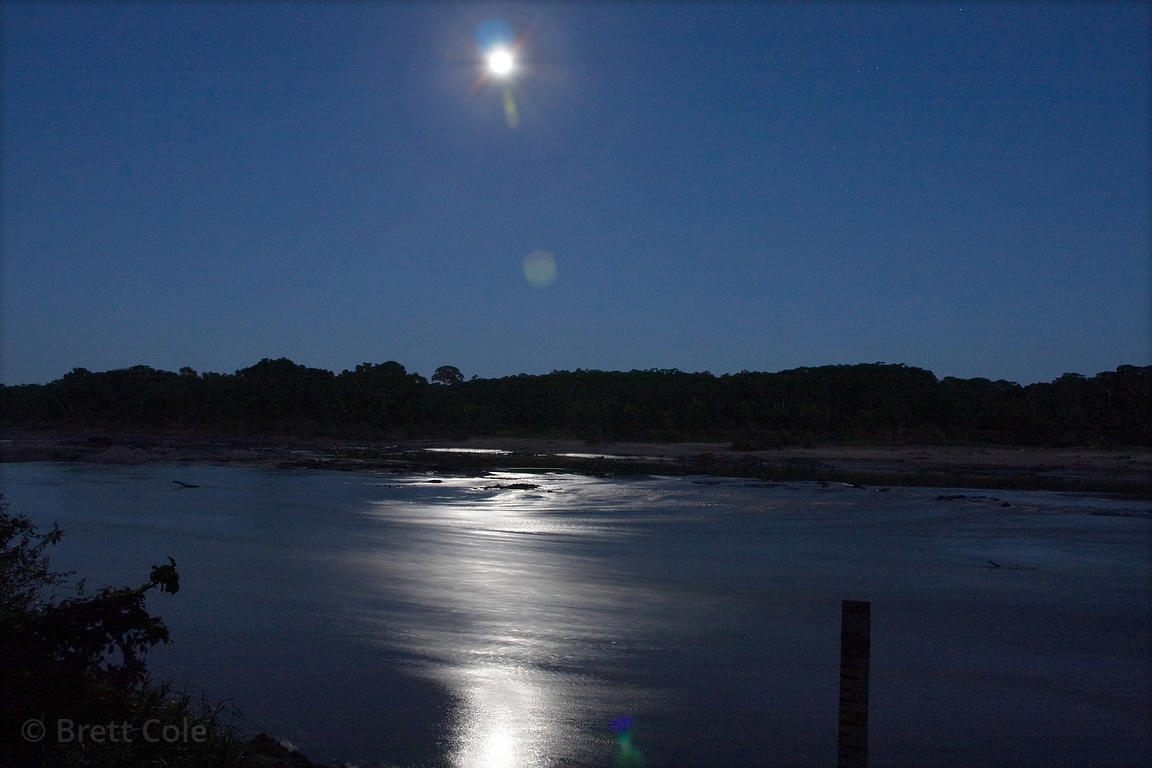 Full moon at night over the Tambopata River, Peruvian Amazon