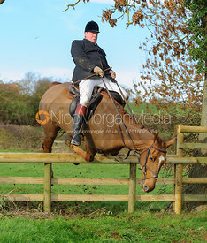 Gordon Hall jumping a hunt jump