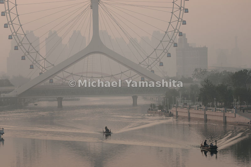Eye of Tianjin Ferris Wheel from Beiyingkou Bridge at sunrise
