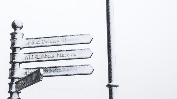 Signpost on a snowy day, Cromer, Norfolk