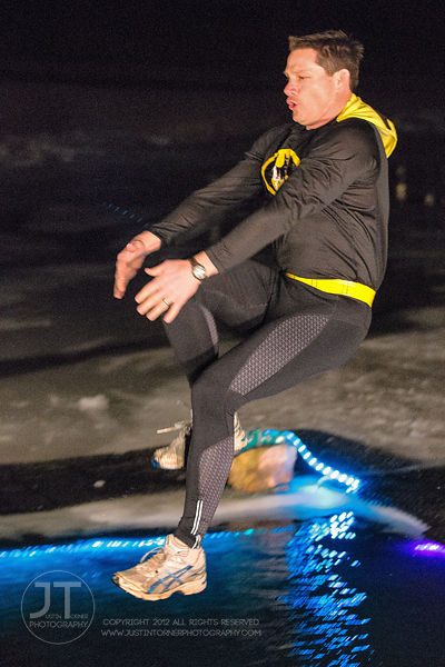 Brooks Simpson jumps into the frigid water during the Hawkeye Wrestling Club's Polar Plunge at the Brown Deer Country Club in...
