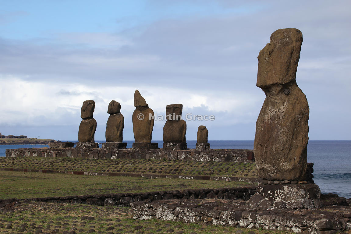 The five Vai Uri (Dark Water) moai with Ahu Tahai moai in the foreground, Tahai complex, Easter Island