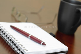 Spiral Notebook on Desk Picture