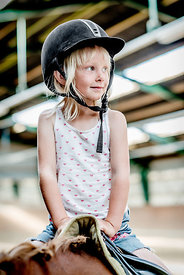 Young Danish girl riding a horse 5