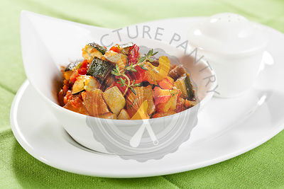 Traditional vegetable ratatouille on green background