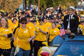 Members of the Alumni Band march in the University of Iowa homecoming Parade on Washington St in Iowa City on Friday Septembe...
