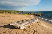 dugout canoe lying on a fishing beach, lake Niassa, Mozambique