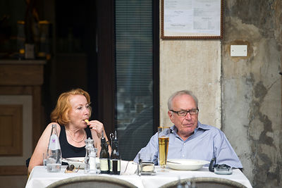 Italy - Verona - A elderly couple sit at a restaurant table in the Piazza Erbe