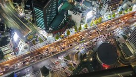 Bird's Eye: Tight Shot Above the Lights of Major Roads Crossing One Another In Tokyo At Night