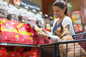 Young Woman Shopping in Pet Store with French Bulldog
