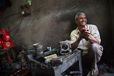 Worker at a small engine repair shop, Jaipur, Rajasthan, India