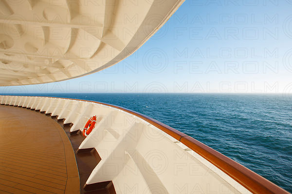 cruise ship rail with ocean horizon