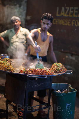 A man cooks dinners at a market in Bandra East, Mumbai, India.