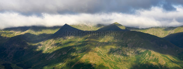 Striding Edge and Swirral Edge leading to the summit of Helvellyn with Catstye Cam on the right. Patterdale English Lake Dist...