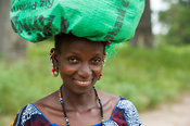 Fula woman carrying a bag to the market, the Gambia