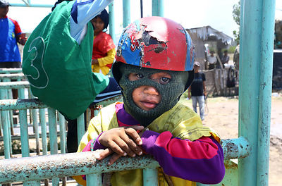 Before a race Firman,  5 years old in the starting stalls. This is the youngest jockey of Sumbawa. Pre-departure is long. Fir...