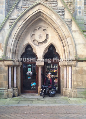 Woman in a wheelchair exploring the sights of England