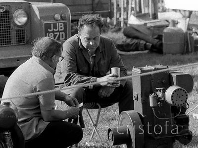 men talk about their Lister single cylinder engine at the St Agnes West of England Steam Fair