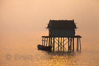 A fishing hut at sunrise in the East Kolkata Wetlands, Kolkata, India.