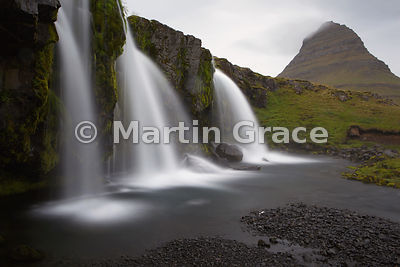 Kirkjufellsfoss waterfall with Kirkjufell mountain behind, Snaefellsnes peninsula, Iceland