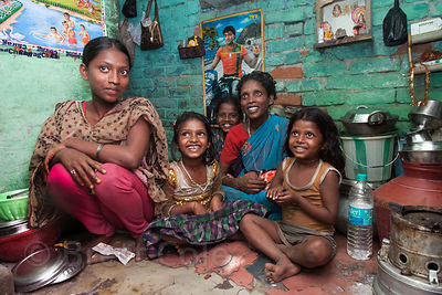 "A family shares their tiny house in a ""slum"" area in Howrah, India. Average home size in some parts of the city is less than ..."