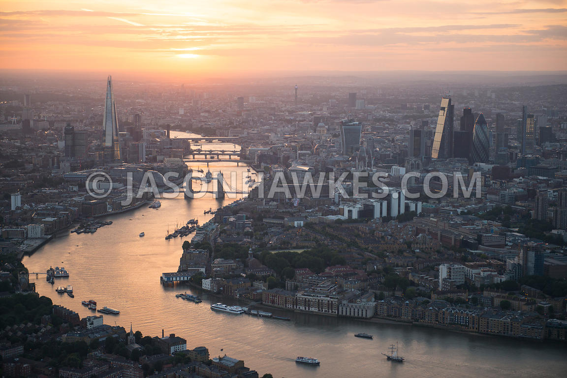 Aerial view over the River Thames at sunset looking West, London